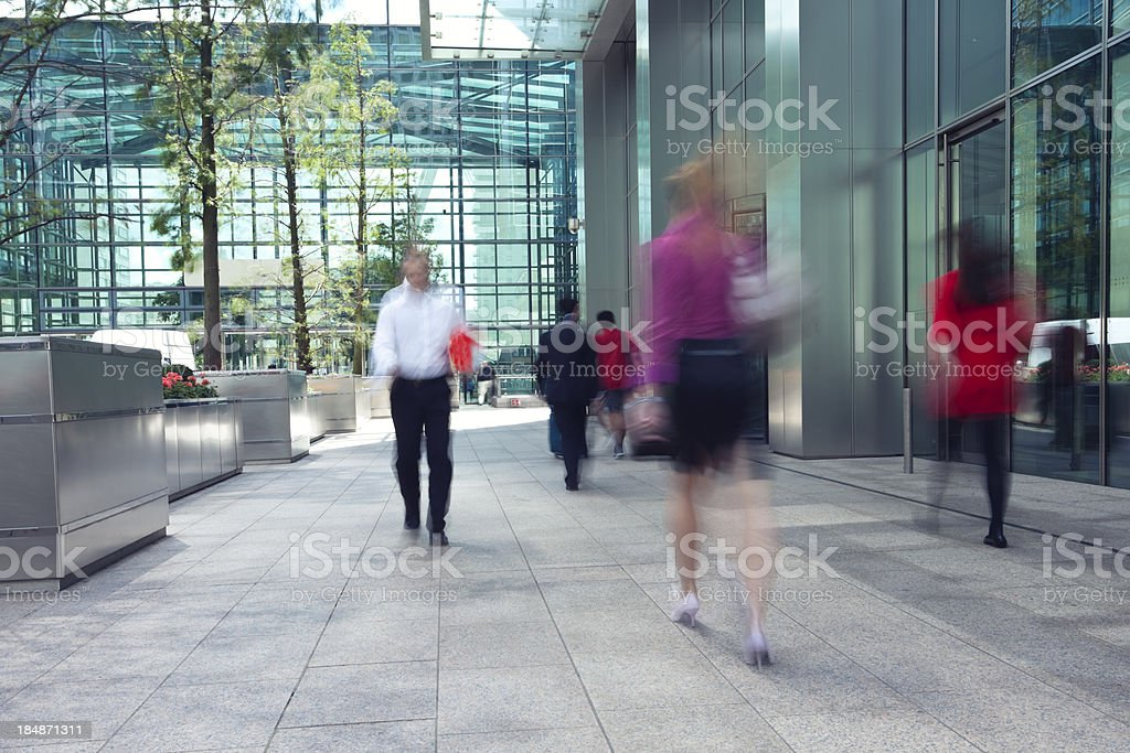 Motion blur photo of people in financial district royalty-free stock photo
