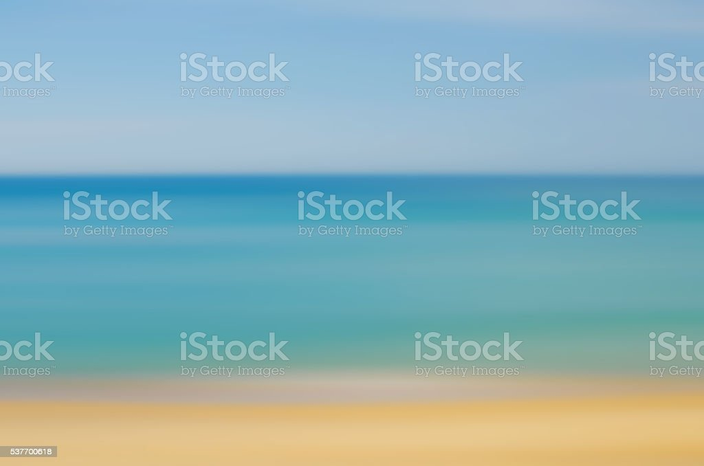 Motion blur tropical beach with sun light stock photo