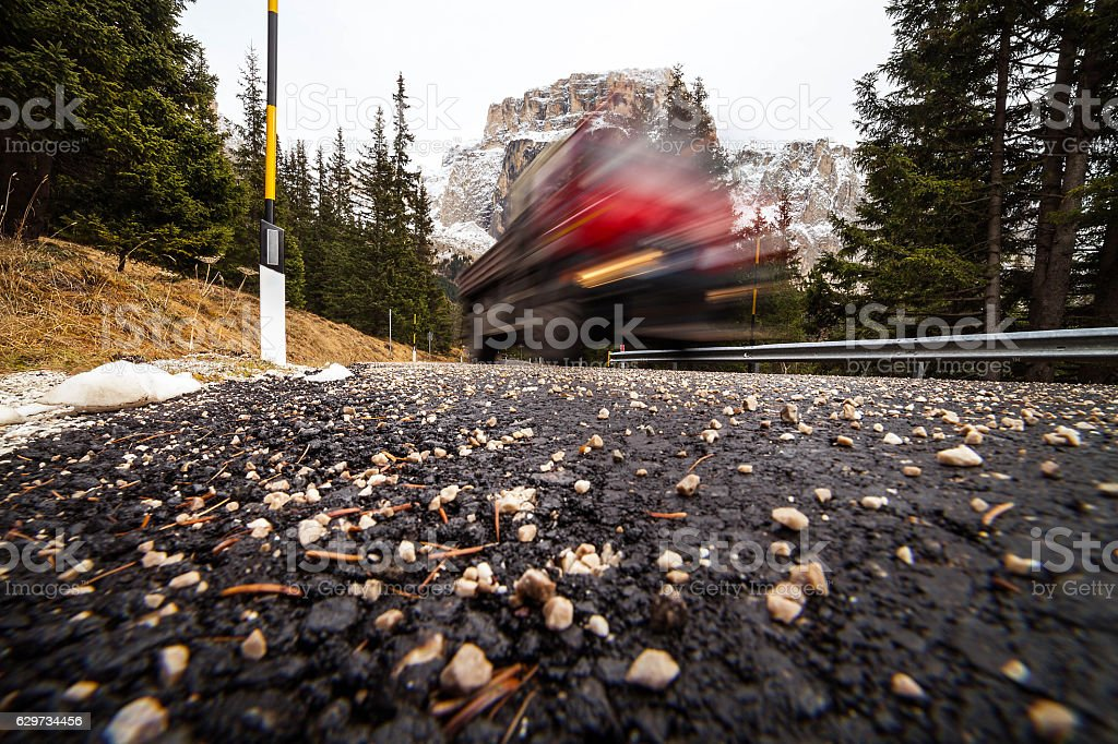 Motion blur vehicle in mountain's road stock photo