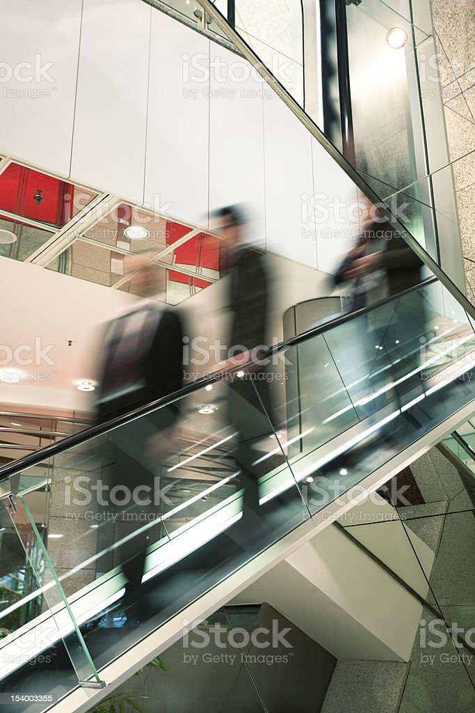 Motion Blurr of Businesspeople on Escalator royalty-free stock photo