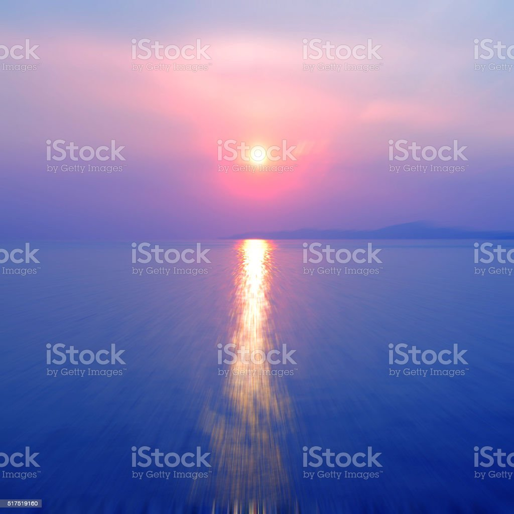 Motion blurred background of sunset on the sea stock photo