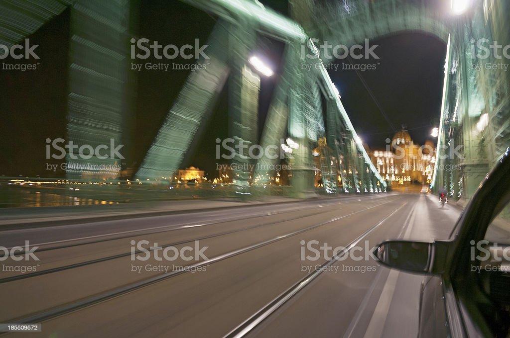 Motion blurred bridge by night royalty-free stock photo