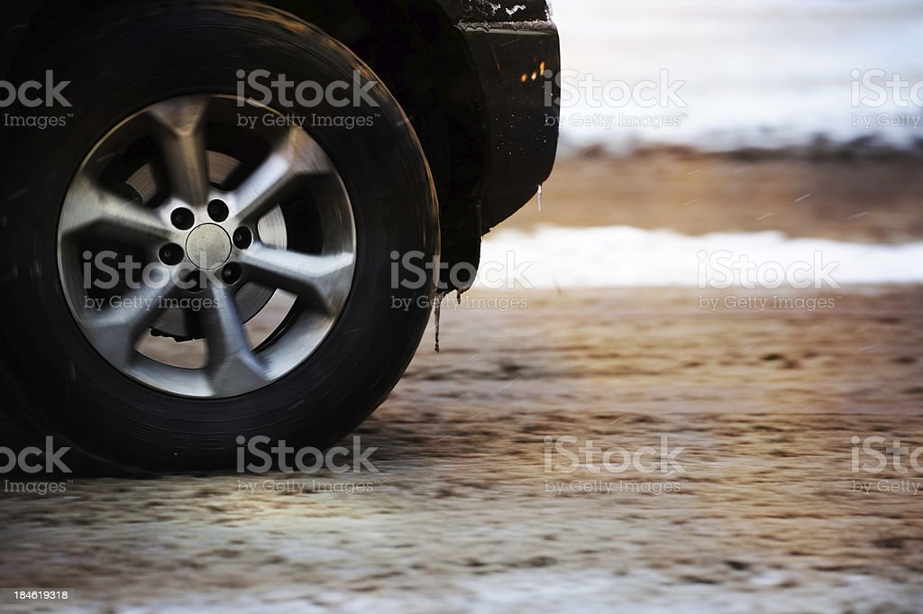 Motion blurred car driving in snow and rain royalty-free stock photo