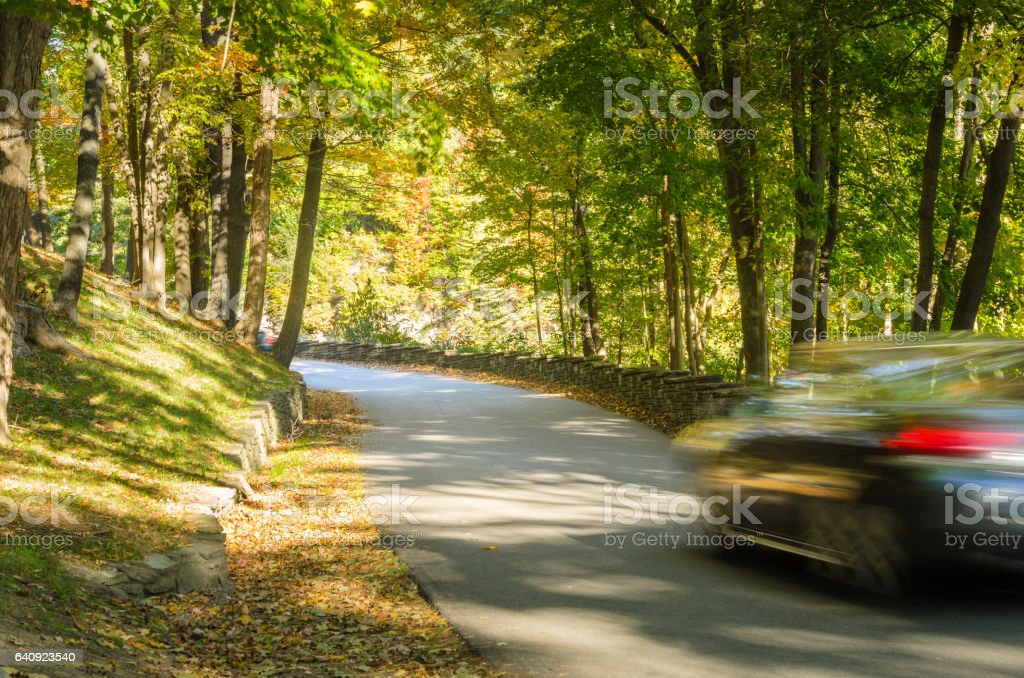 Motion Blurred Car on a Mountain Road stock photo