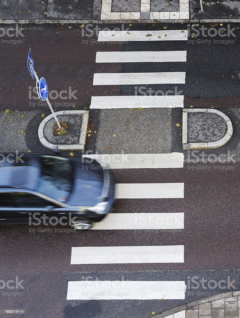 Motion blurred car on zebra crossing royalty-free stock photo