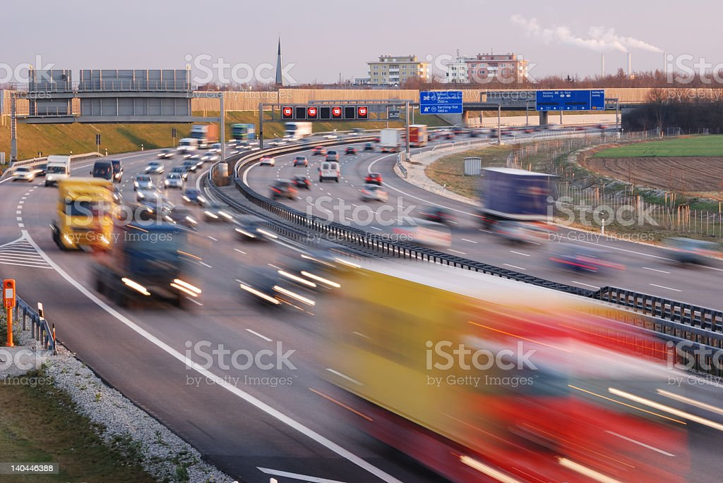 Motion blurred cars and trucks driving on the highway stock photo