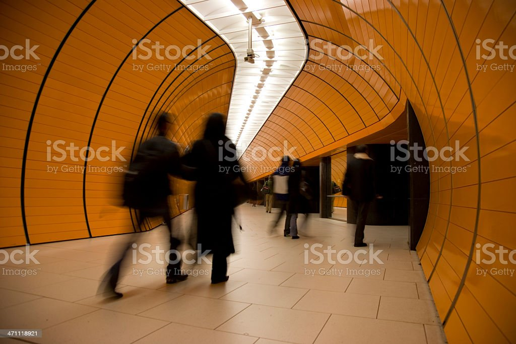 motion blurred couple against modern underground XL royalty-free stock photo