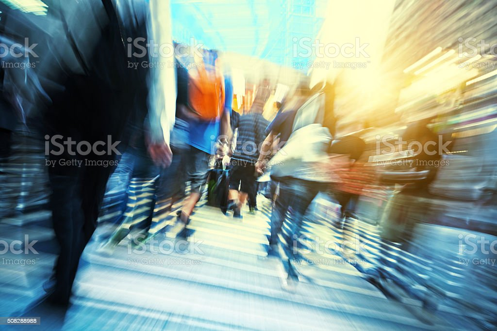 motion blurred crowd of people rushing through Hongkong stock photo