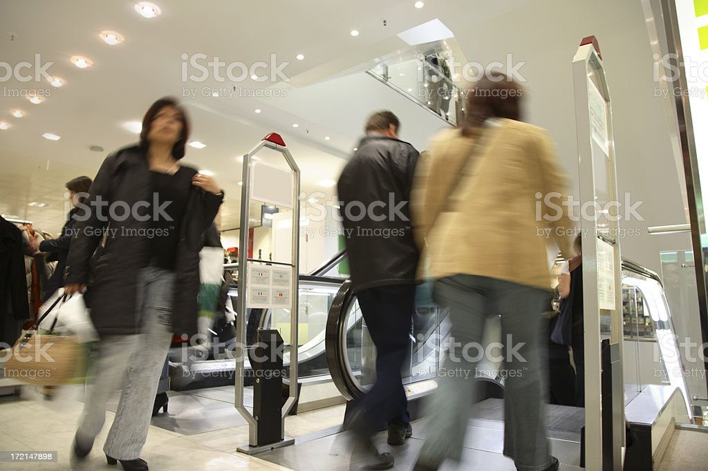 Motion Blurred Customers in Shopping Mall royalty-free stock photo