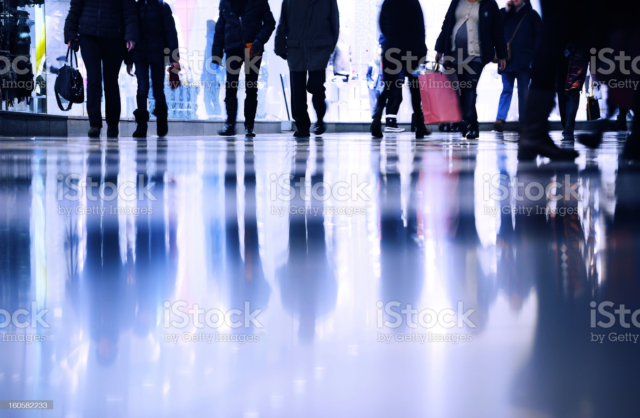 Motion blurred customers walking in shopping mall royalty-free stock photo