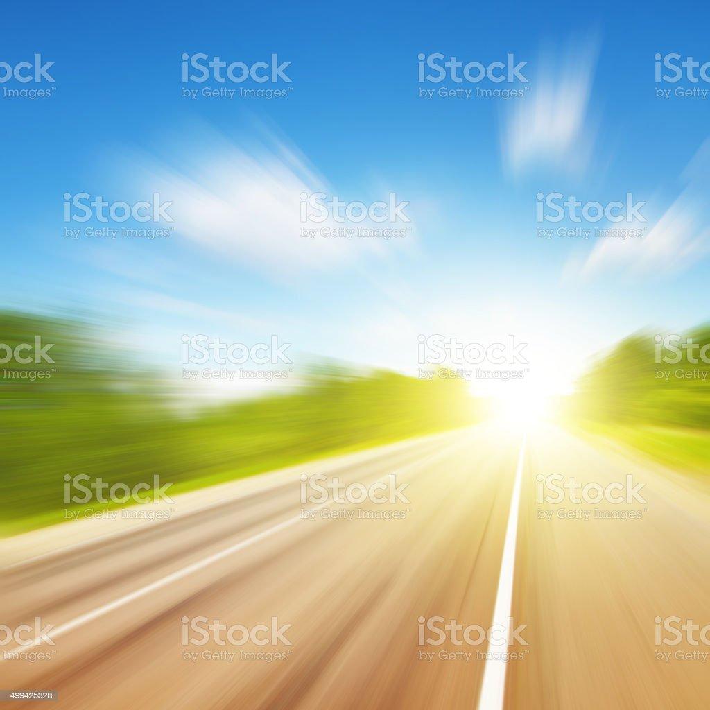 Motion blurred empty asphalt road. stock photo