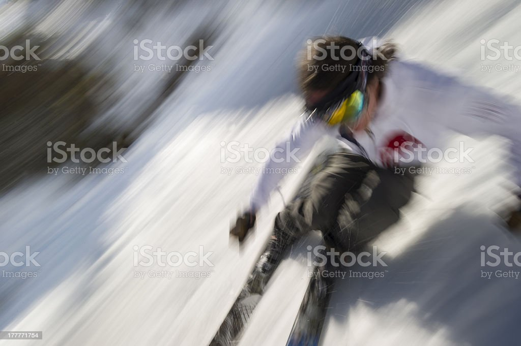 Motion blurred image of an expert skier. stock photo