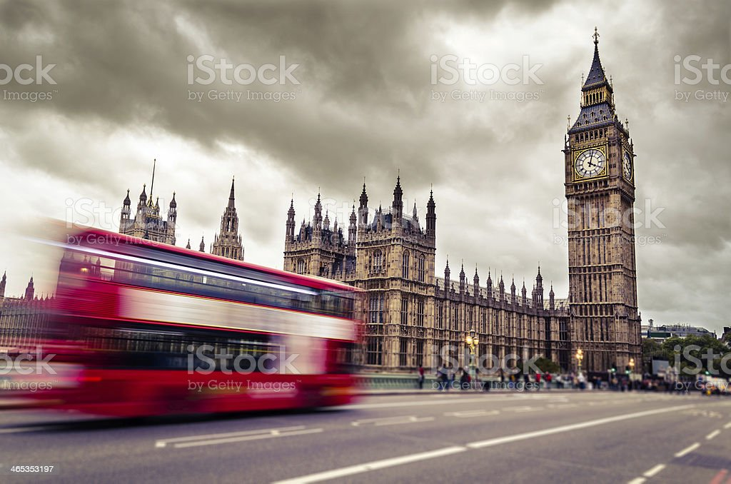 Motion blurred image of double decker bus driving to Big Ben stock photo