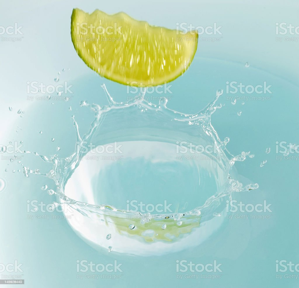 motion blurred lime falling in water royalty-free stock photo