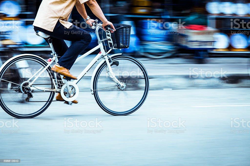 Motion blurred of a man biker stock photo