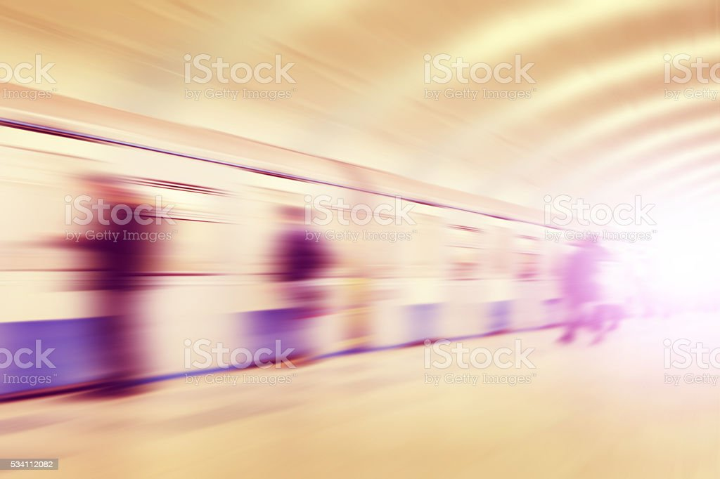 Motion blurred people at subway station. stock photo