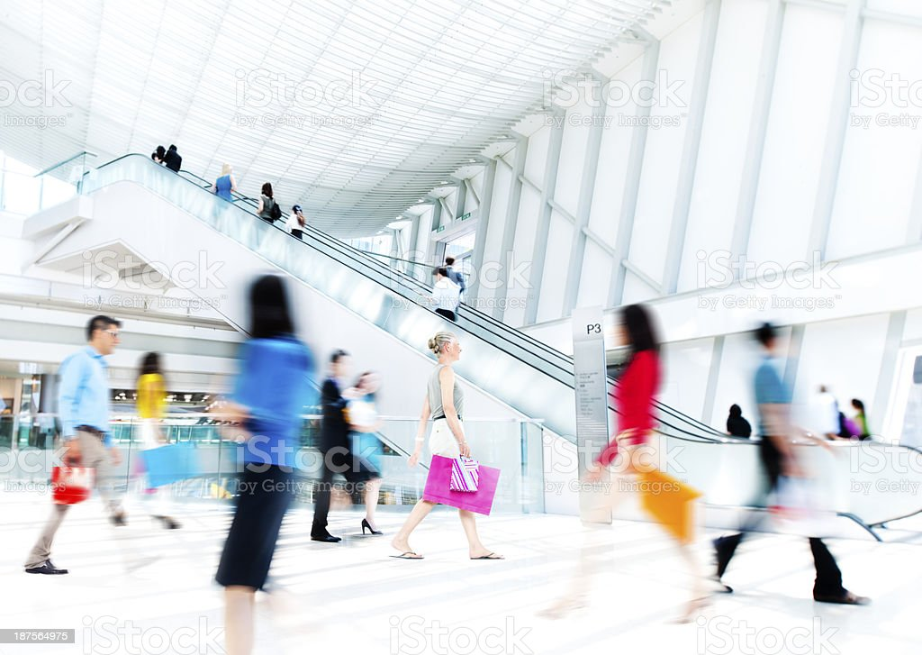 Motion Blurred People in the Shopping Mall stock photo