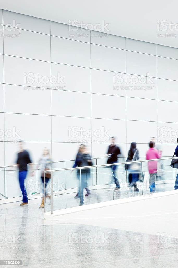 Motion Blurred People Walking Indoors royalty-free stock photo