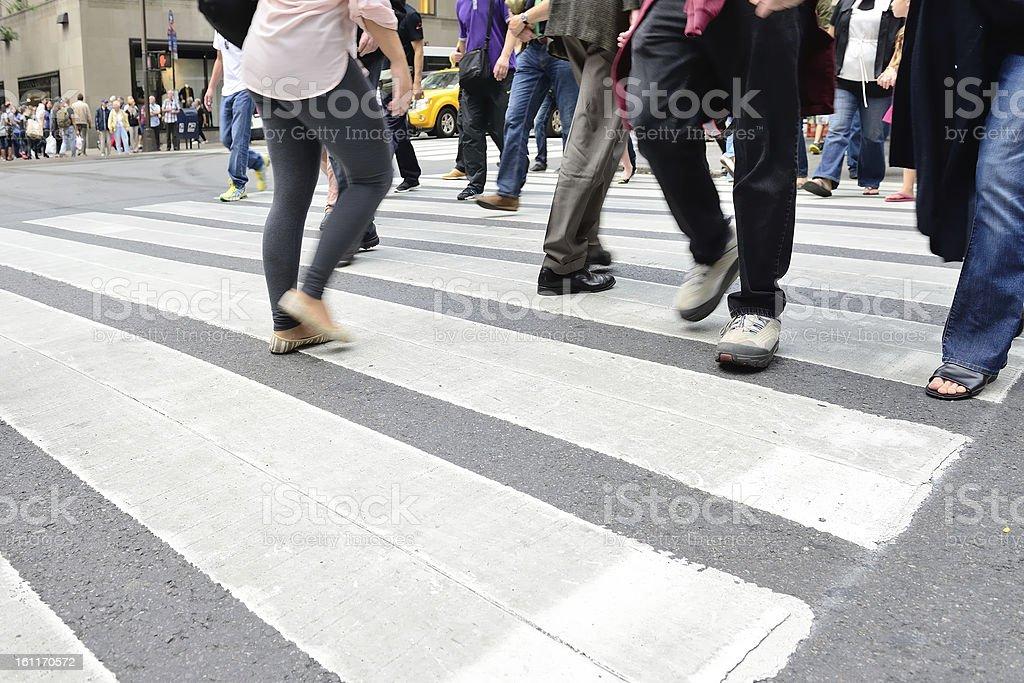 Motion blurred people walking on zebra crossing stock photo