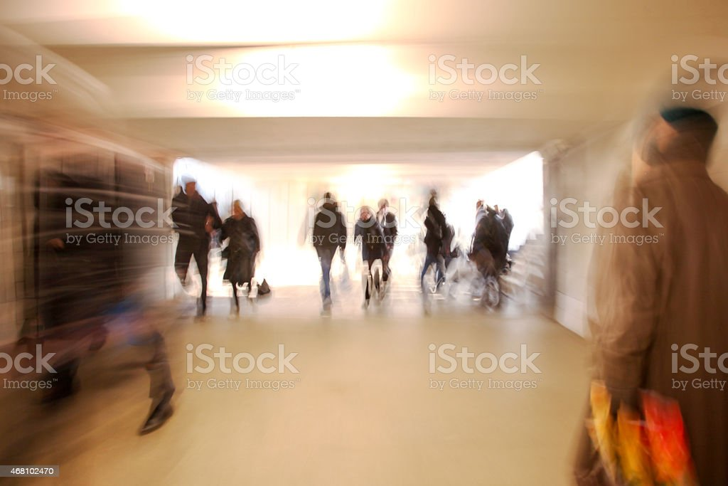 Motion blurred people walking stock photo