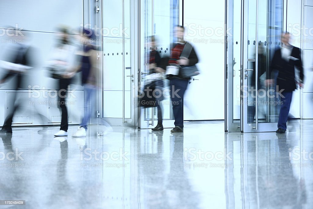 Motion Blurred People Walking Through the Doors royalty-free stock photo