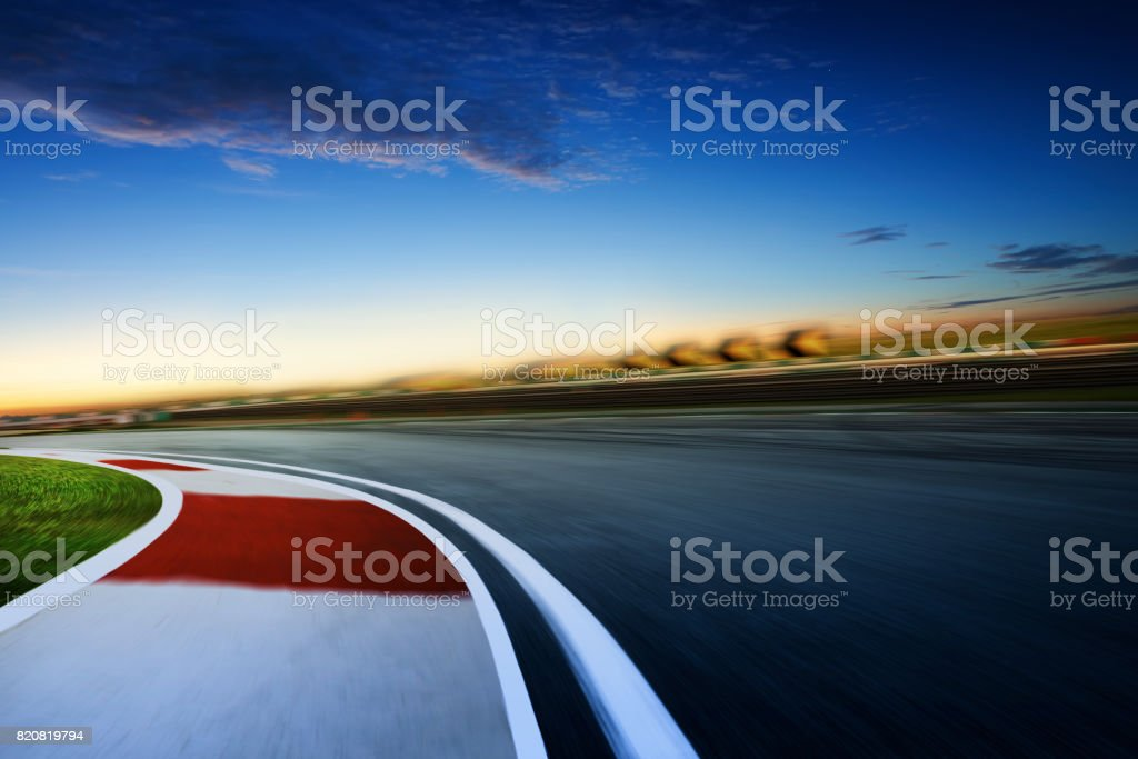 Motion blurred racetrack ,cold mood , early morning scene . stock photo