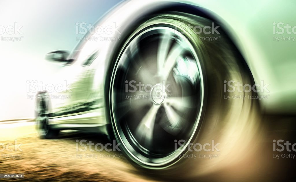 Motion blurred sports car tire stock photo