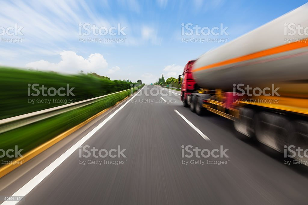 Motion blurred tanker truck on the highway stock photo