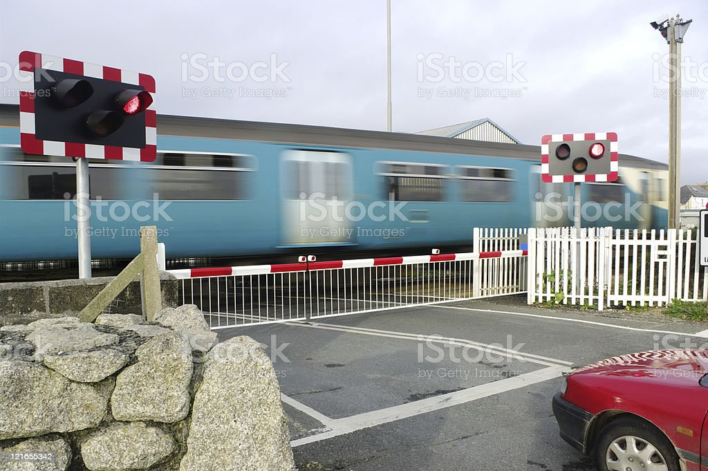 Motion Blurred Train At Level Crossing Cornwall UK royalty-free stock photo