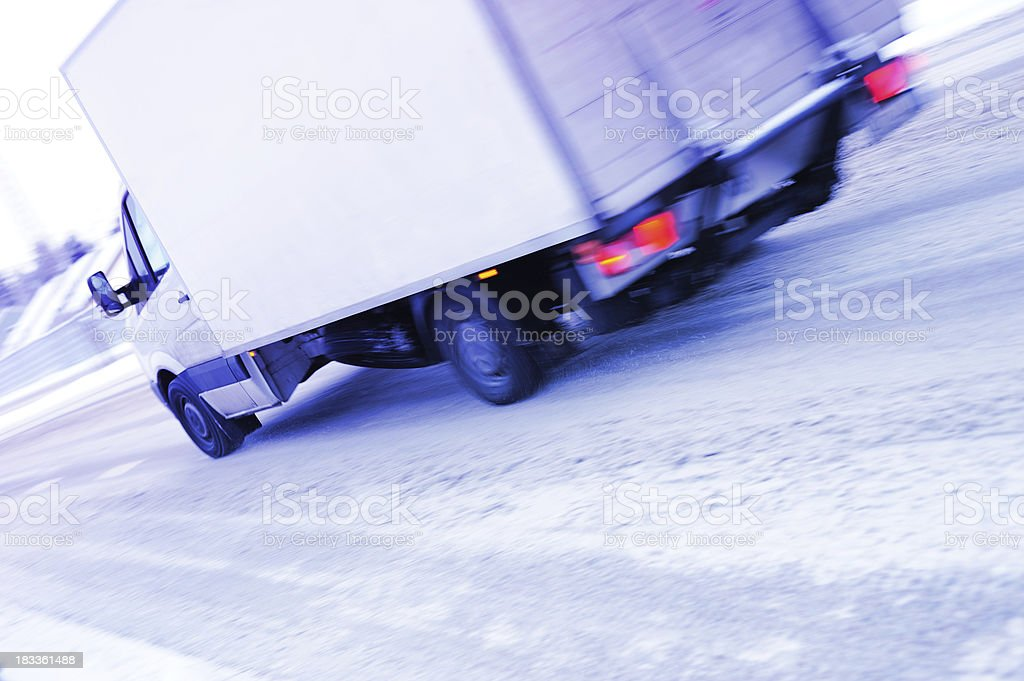 Motion blurred truck on snowy winter road royalty-free stock photo