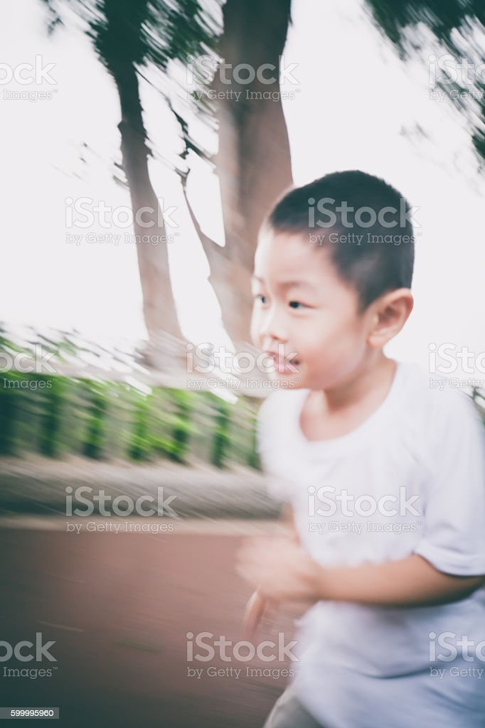 Motion blurred view of child running stock photo