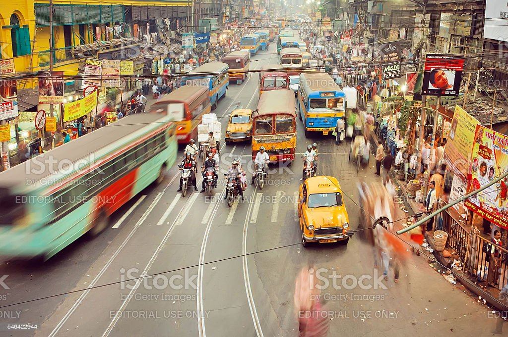 Motion blurs from public buses, cars and rushing people stock photo