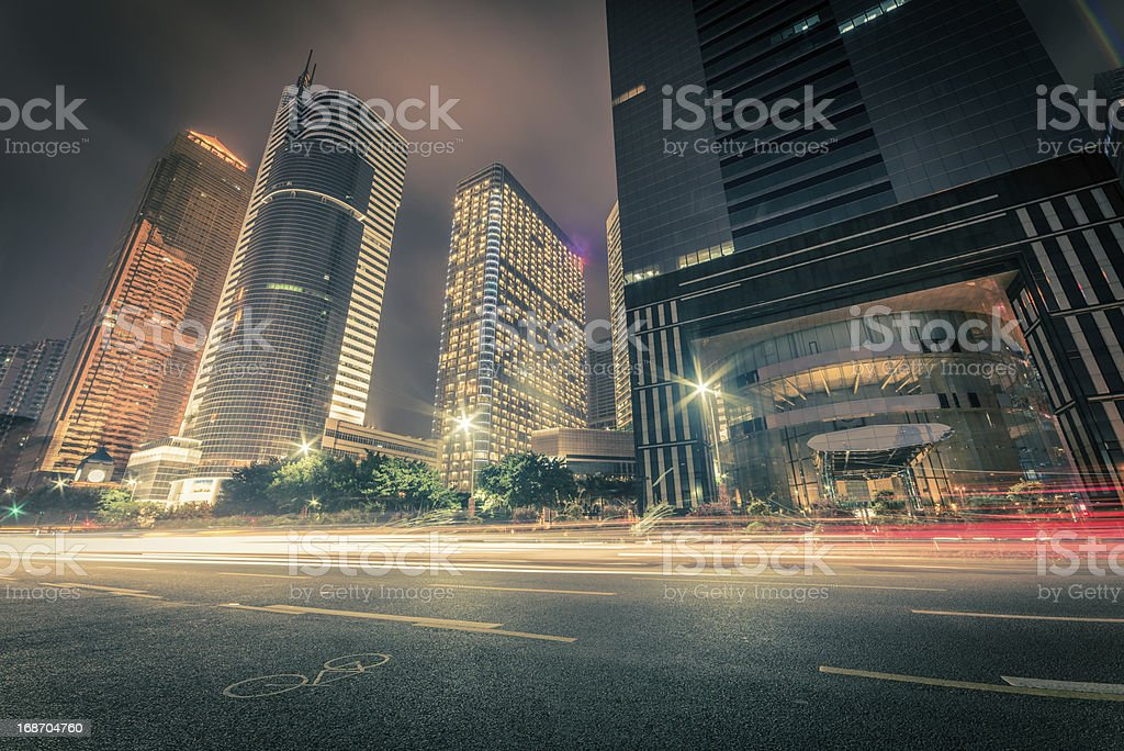 Motion captured traffic on a city street at night royalty-free stock photo