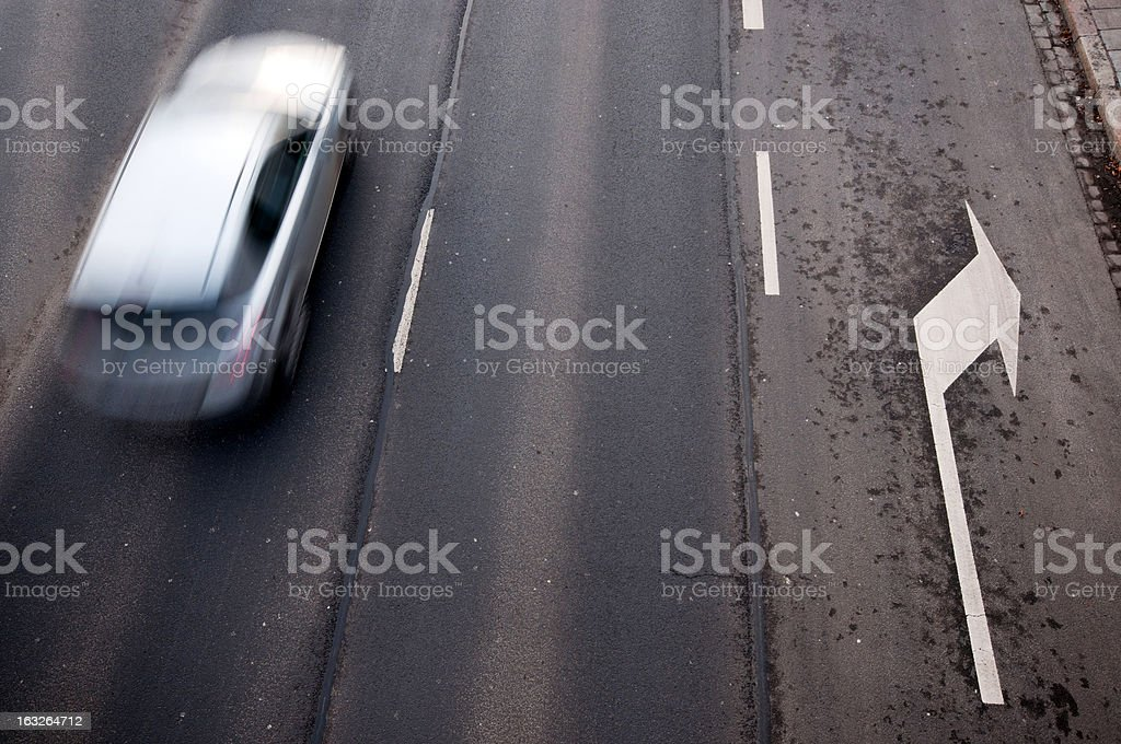 motion car and right turn sign on the street royalty-free stock photo