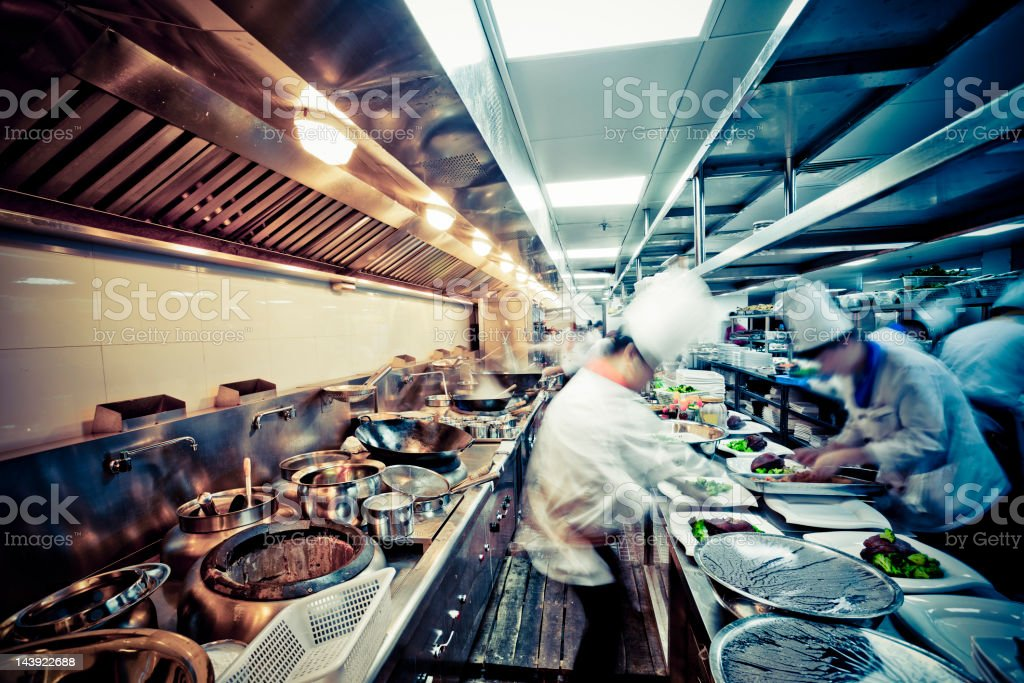 motion chefs  of a restaurant kitchen royalty-free stock photo