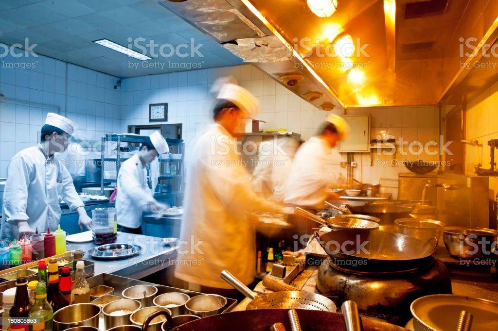 motion chefs of a restaurant kitchen stock photo