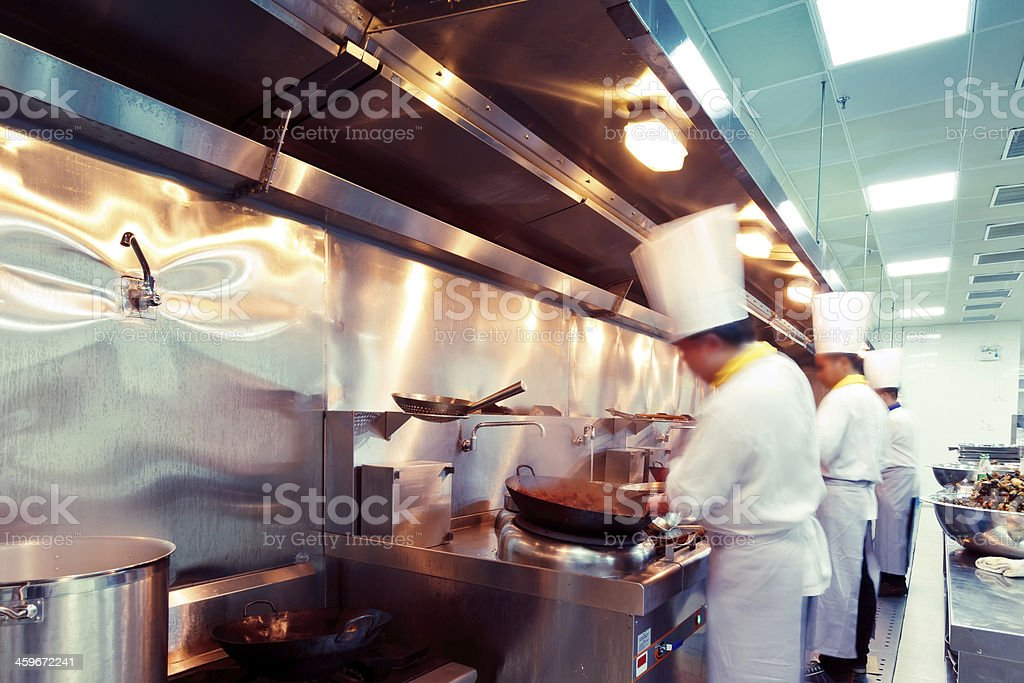motion chefs of a restaurant kitchen stock photo