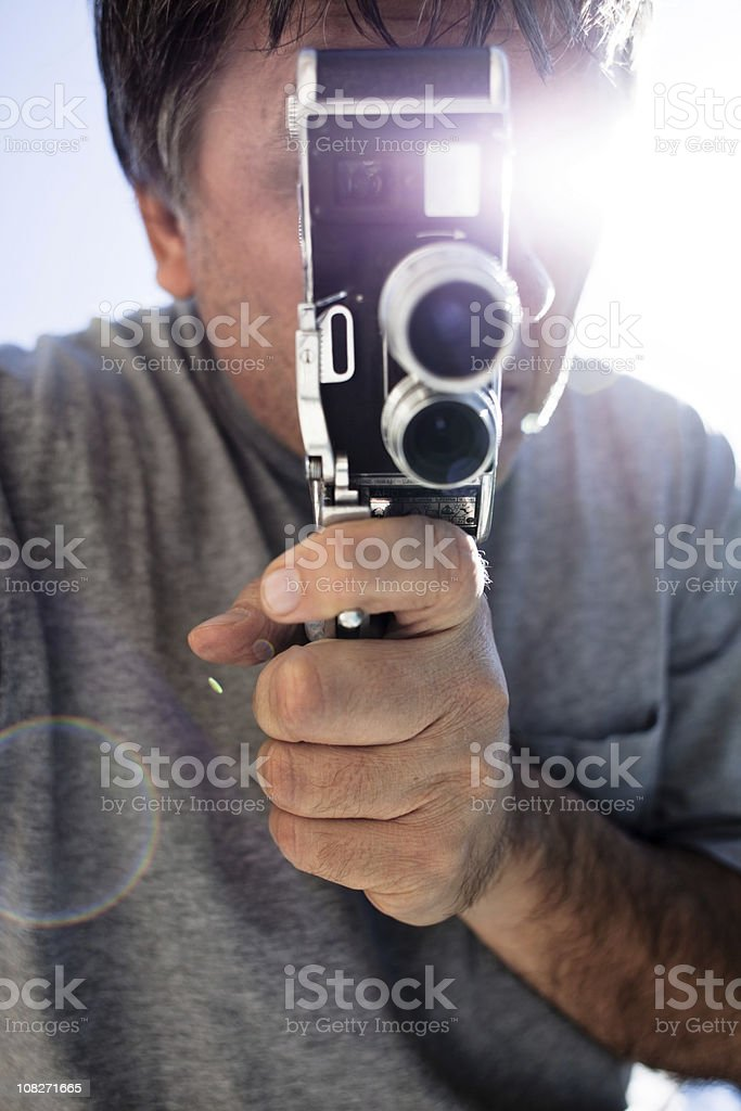Motion film camera in hand stock photo