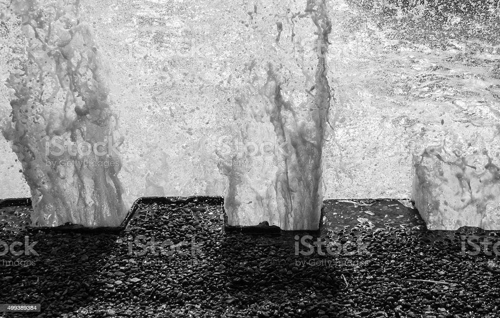 Motion freeze of waves hitting sea wall, Bawdsey, Suffolk, UK stock photo