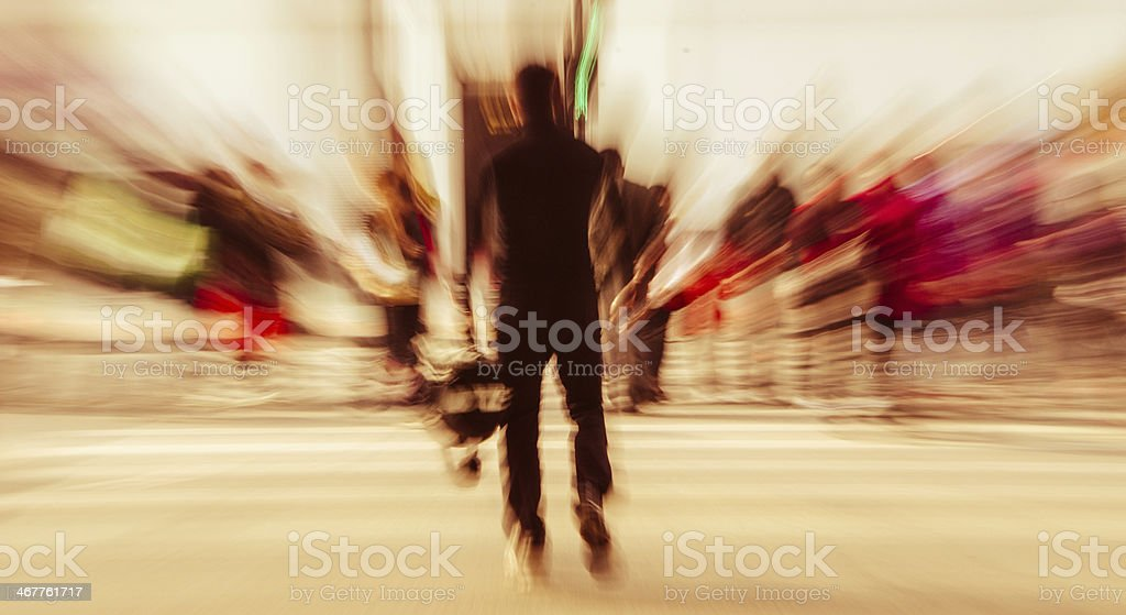 Motion image of male silhouette on a busy street stock photo