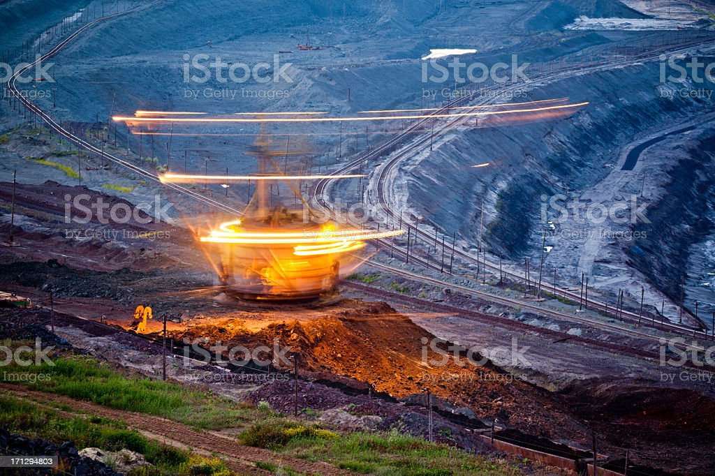 Motion light. Excavator working at night royalty-free stock photo