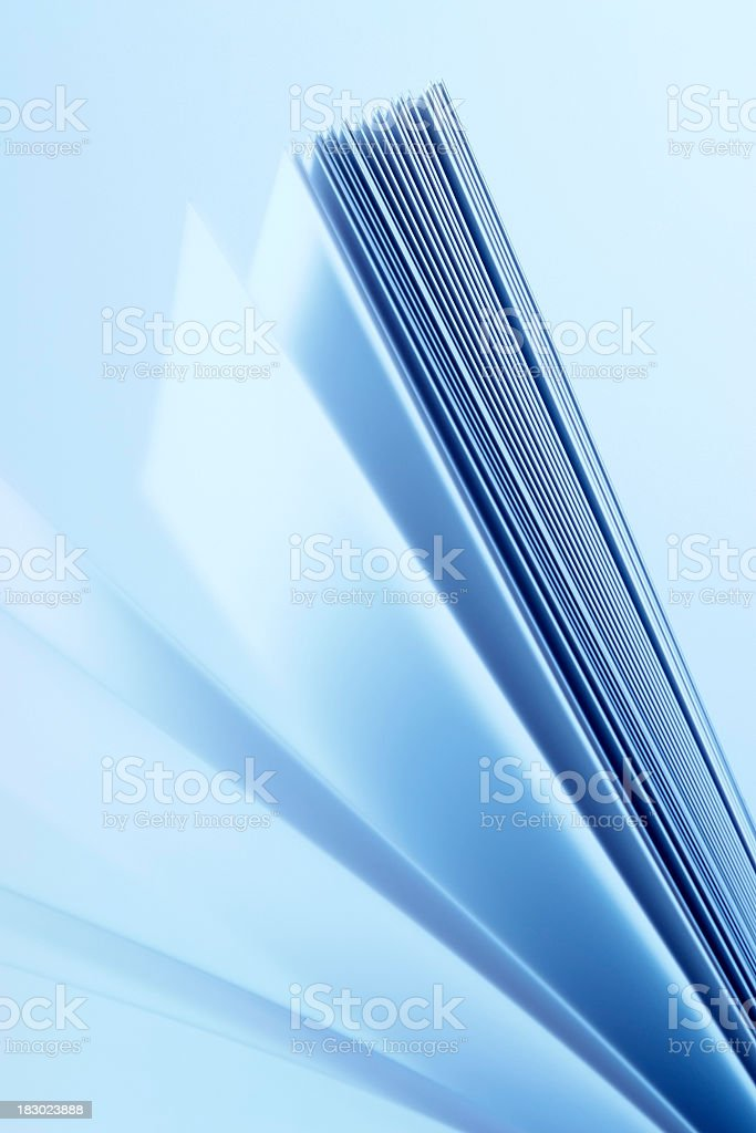 Motion of blank book pages with blue tinted image royalty-free stock photo
