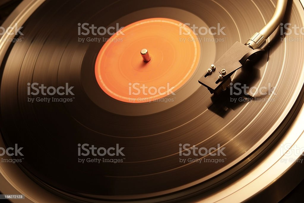 Motion of the turntable of warm toned image stock photo