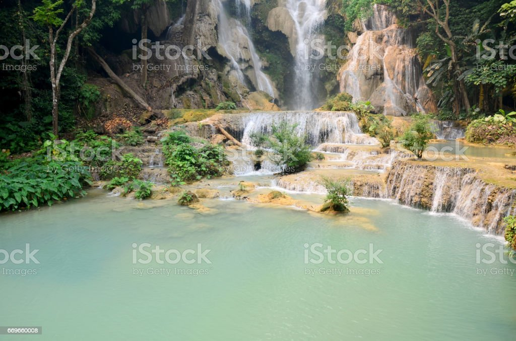 Motion of water at Kuang Si Falls or Tat Kuang Si Waterfalls stock photo