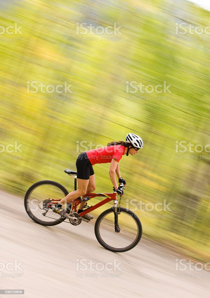 Motion Shot of Female Riding Her Bicycle royalty-free stock photo