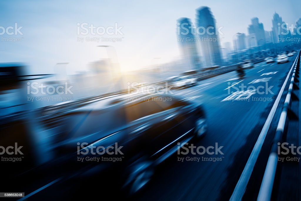 motion traffic on highway wity city background stock photo