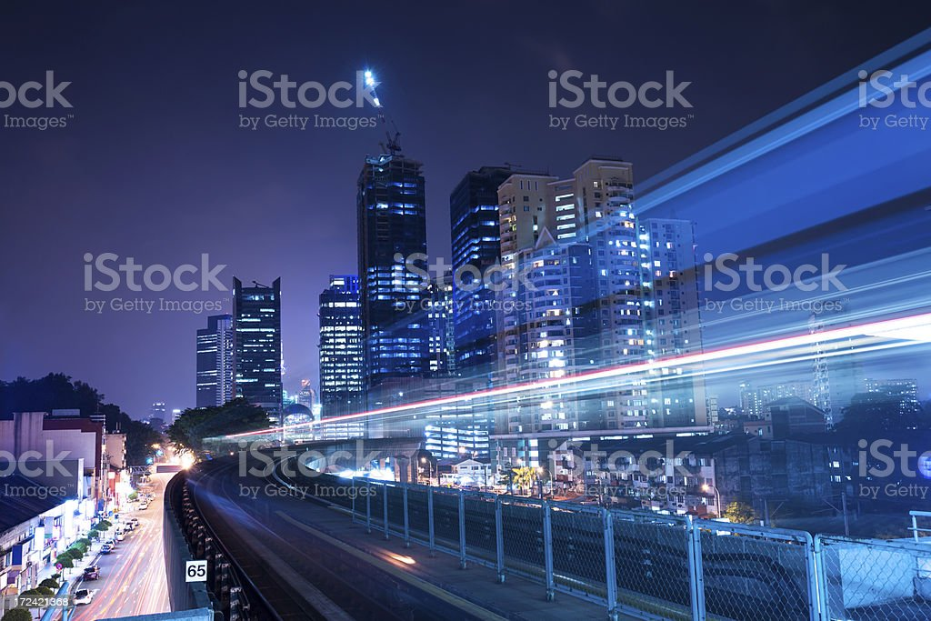 Motion-blur image of train in modern city royalty-free stock photo