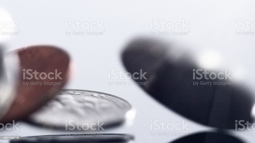 Motion-blurred coins falling in close up stock photo
