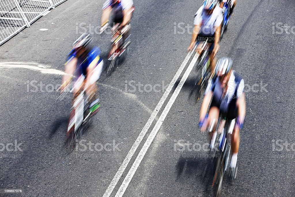 Motion-blurred overhead view of cyclists in a race royalty-free stock photo