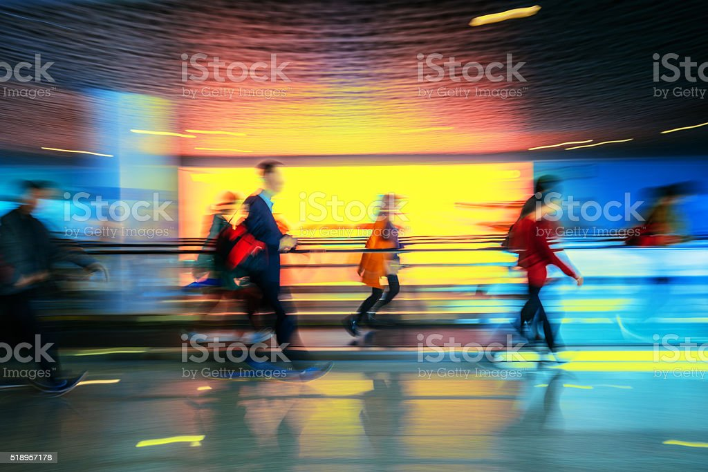 Motion-blurred people walking to the airport terminal stock photo